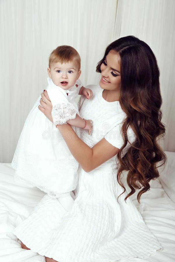 Beautiful family photo. gorgeous mother with her little cute baby girl stock photo