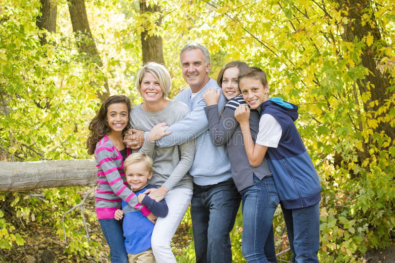 Beautiful family portrait outdoors on a sunny day royalty free stock images