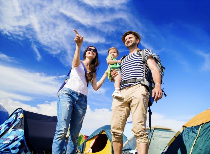 Beautiful family at summer festival. Beautiful young family at summer music festival stock photos