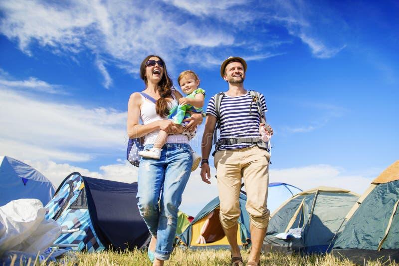 Beautiful family at summer festival. Beautiful young family at summer music festival stock photo