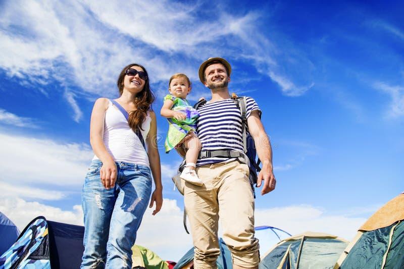Beautiful family at summer festival. Beautiful young family at summer music festival royalty free stock photography