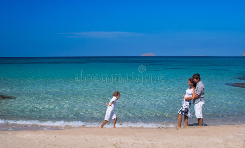 Beautiful family walking on a tropical beach stock images