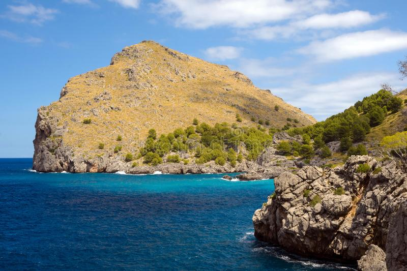 Beautiful famous bay of Sa Calobra on the island of Mallorca, Spain. Turquoise sea, rocks and pines. Travel to the Balearic royalty free stock photo