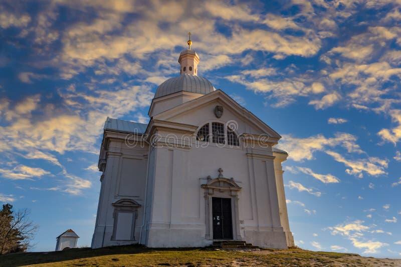 Beautiful and famous St. Sebastian`s chapel Svaty Kopecek - in czech on a sunset. Mikulov, South Moravian region. Czech Republi stock image
