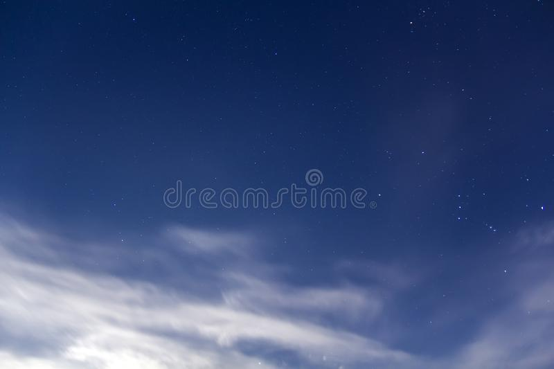 Beautiful fantastic bright high blue sky with soft puffy white clouds, symbol of purity and holiness, kingdom of fantasy and imagi. Nation stock photo
