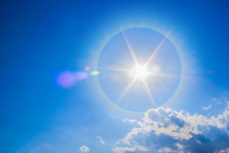 Beautiful fantastic sun halo phenomenon in sky. Sun with circular rainbow stock photo