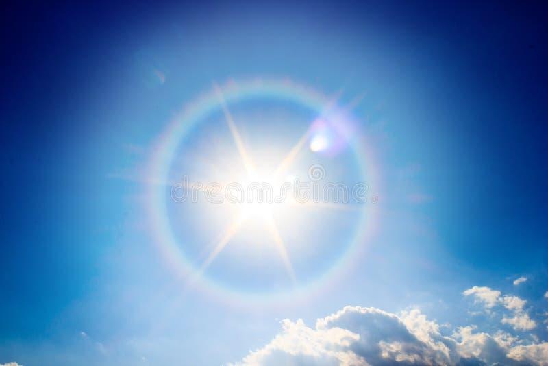 Beautiful fantastic sun halo phenomenon in sky. Miraculous sun with circular rainbow stock photo