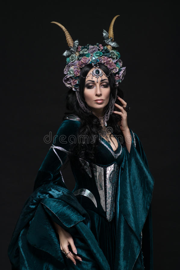 Beautiful fantasy elf woman in floral crown. And medieval dress stock photography