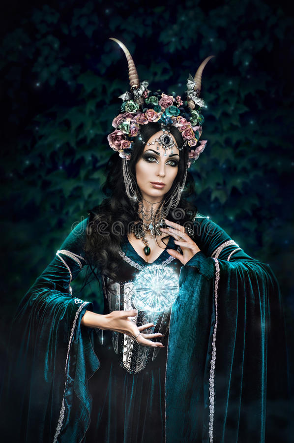 Beautiful fantasy elf woman. In flower crown and medieval dress royalty free stock photography