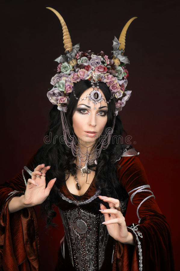 Beautiful fantasy elf woman. In flower crown and medieval dress royalty free stock images