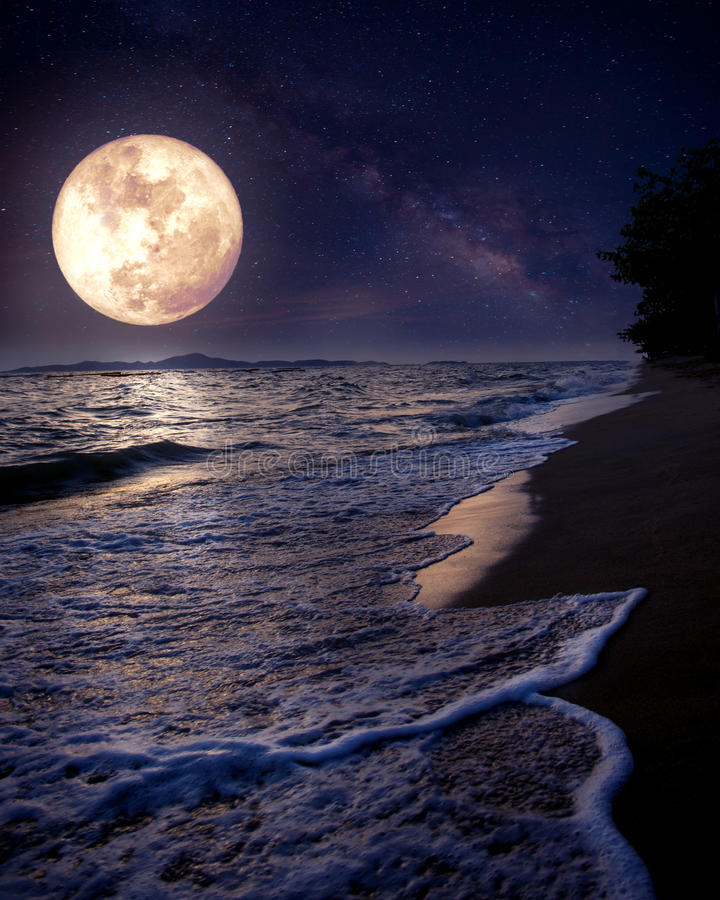 Beautiful fantasy tropical beach with Milky Way star in night skies, full moon. Retro style artwork with vintage color tone Elements of this moon image stock images