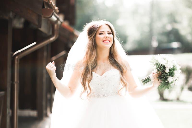 Beautiful fashion bride in wedding dress posing royalty free stock photo