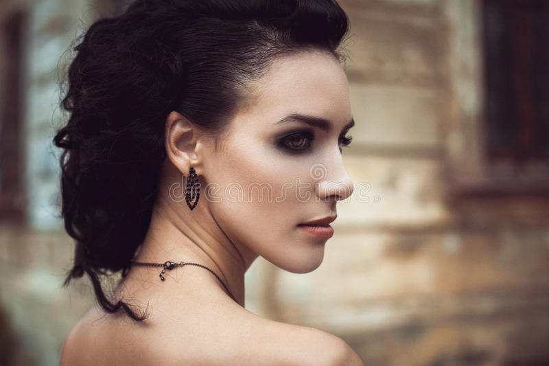 Beautiful fashion brunette woman creative hairstyle street portrait stock photography