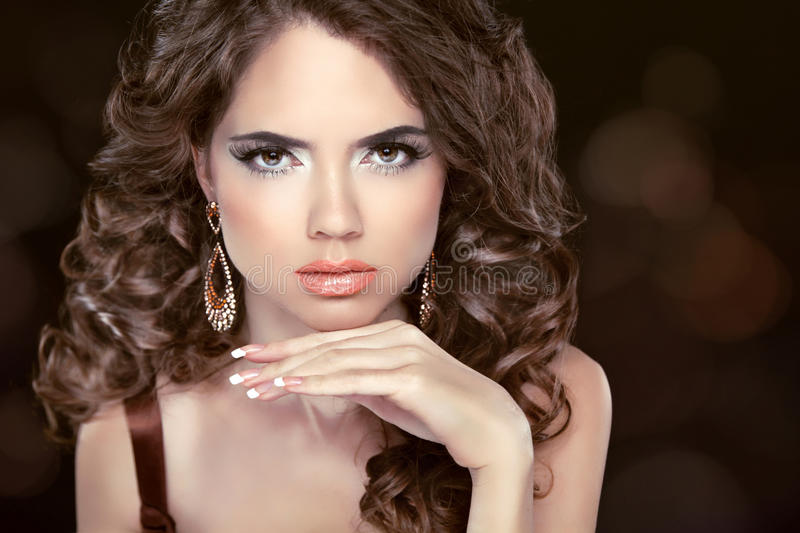 Beautiful fashion brunette woman model with wavy long hair and f stock photography