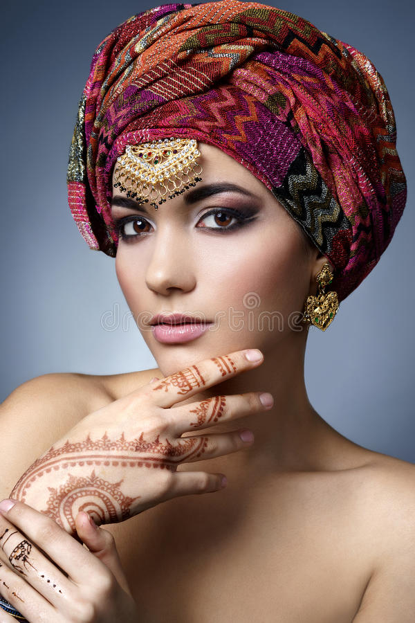 Beautiful fashion east woman portrait with oriental accessories royalty free stock image