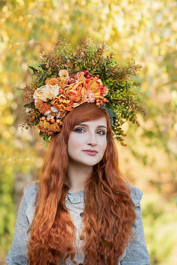 Beautiful fashion female with autumnal make up and red hair style stock photos