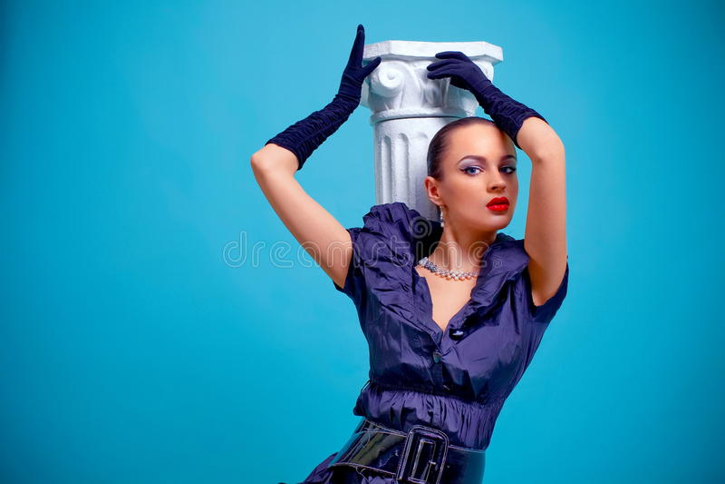 Beautiful fashion girl on the blue background stock image