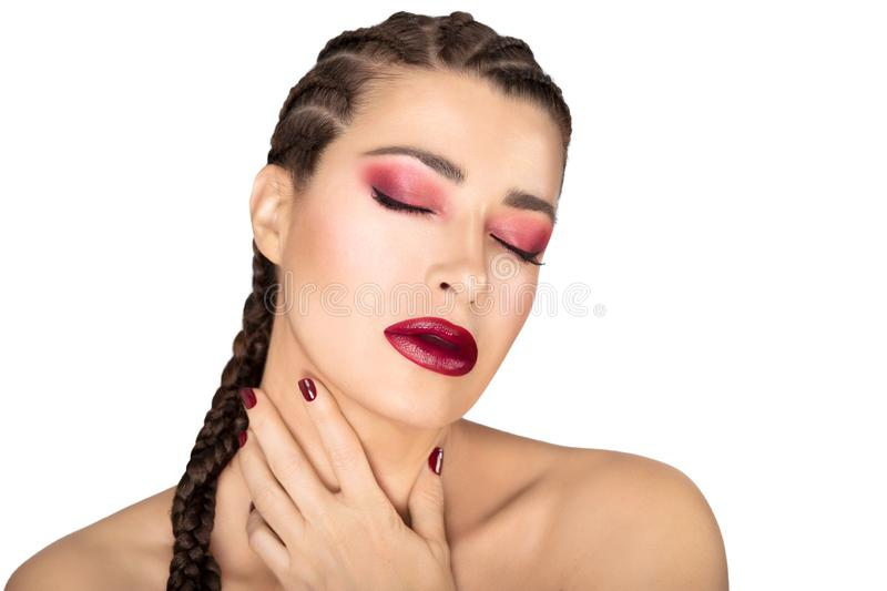 Beautiful fashion girl with braided hair, red wine  wine, nails and eye shadow. Beauty makeup concept royalty free stock images