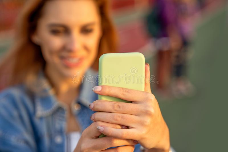 Beautiful fashion girl doing selfie with phone at sunset stock photos