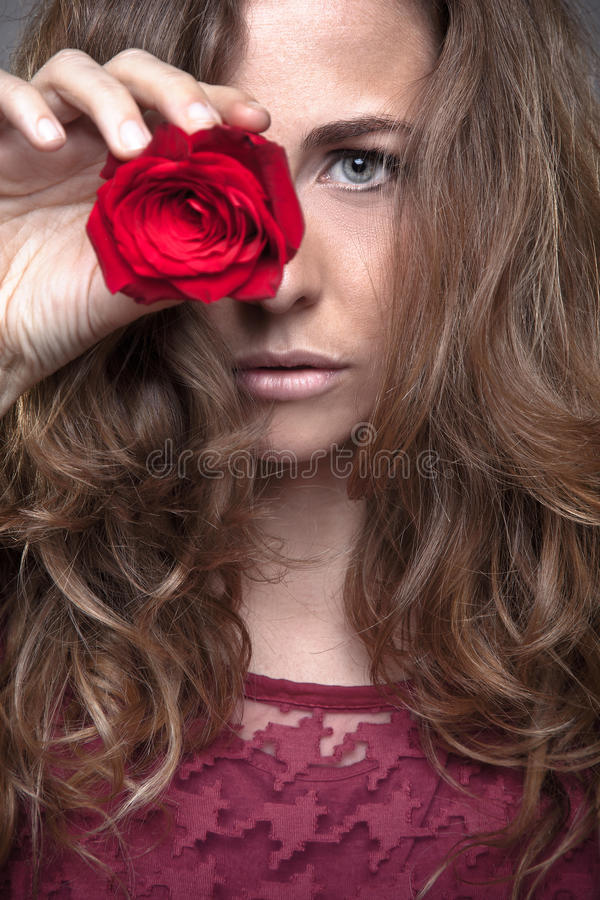 Beautiful fashion girl with red rose stock photo