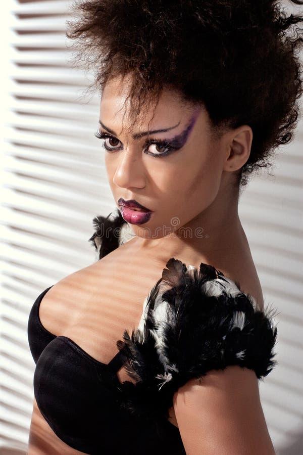 Beautiful fashion model with creative dark makeup
