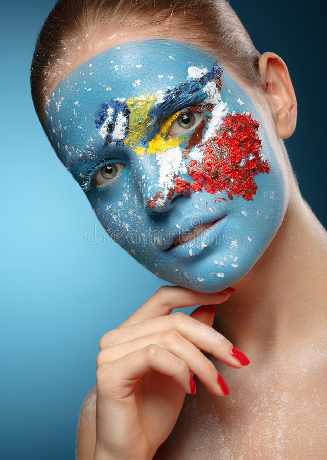 Beautiful fashion model with face art in winter style. royalty free stock photography