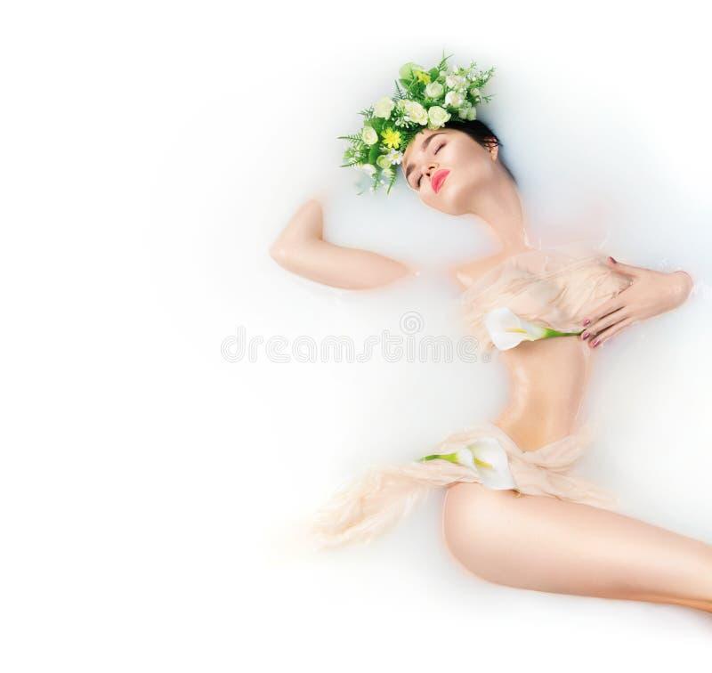 Beautiful fashion model girl taking milk bath stock photo