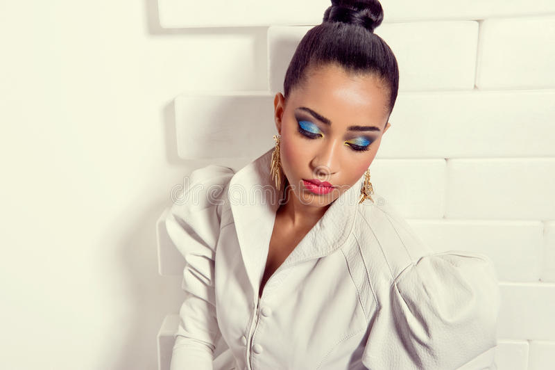 Beautiful fashion model in leather jacket stock image