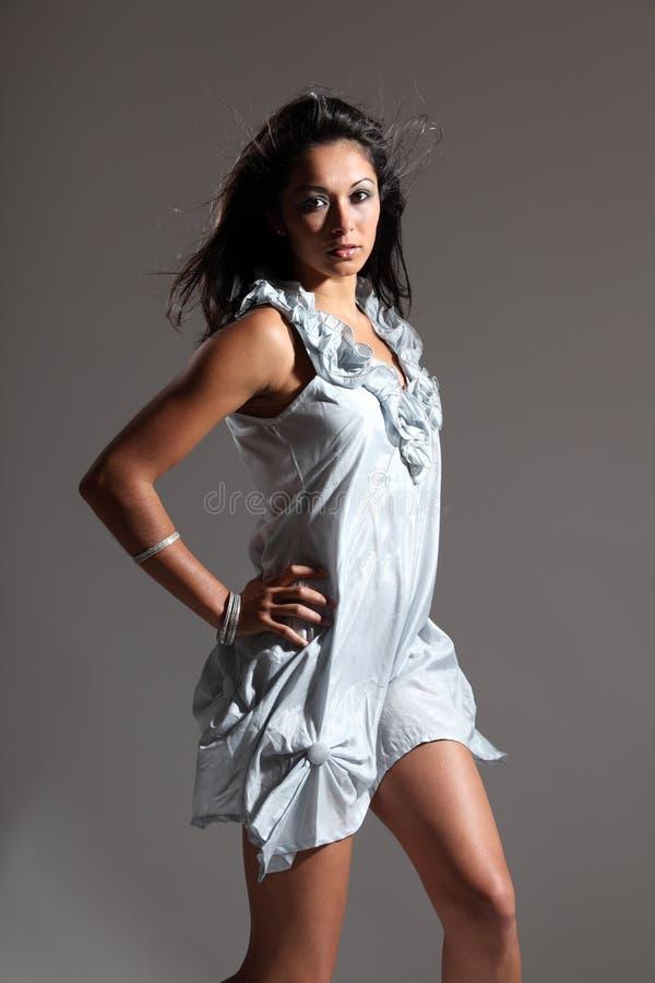 Beautiful fashion model in light blue short dress royalty free stock photos
