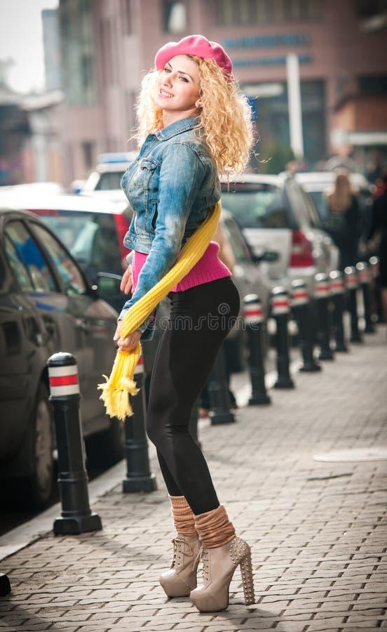 Beautiful fashion model portrait posing on street. stock photo