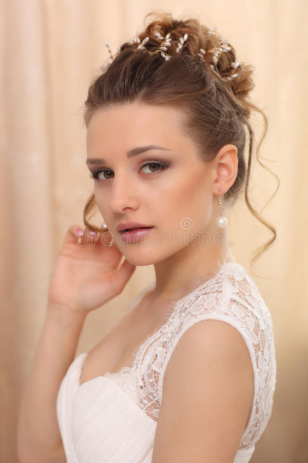 Beautiful fashion model. Sensual bride. Woman with wedding dress, hair and make up. Waiting for groom stock image