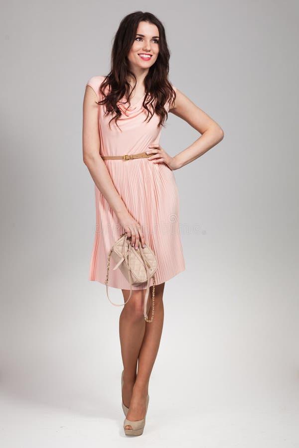 Beautiful Fashion model wearing dress royalty free stock photo