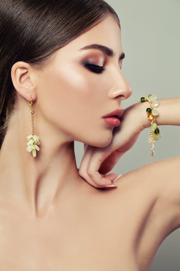 Beautiful Fashion Model Woman Wearing Gold Jewelry stock photo