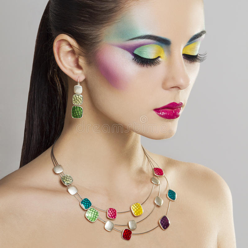 Beautiful fashion portrait of young woman with bright colorful makeup royalty free stock photo
