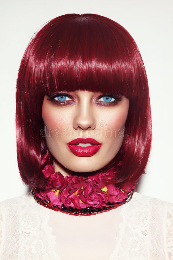 Beautiful fashion redhead girl with bob haircut and stylish make stock photo