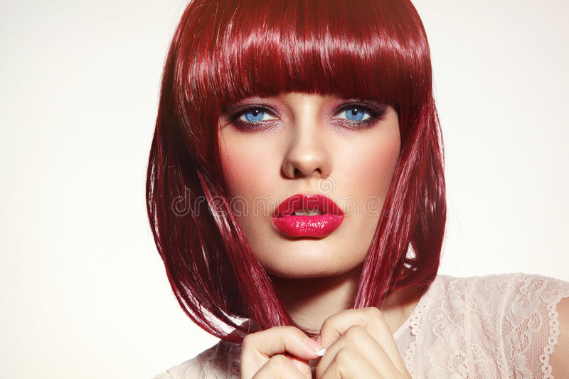 Beautiful fashion redhead girl with bob haircut and stylish make royalty free stock image