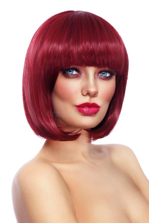 Beautiful fashion redhead girl with bob haircut and stylish make stock image