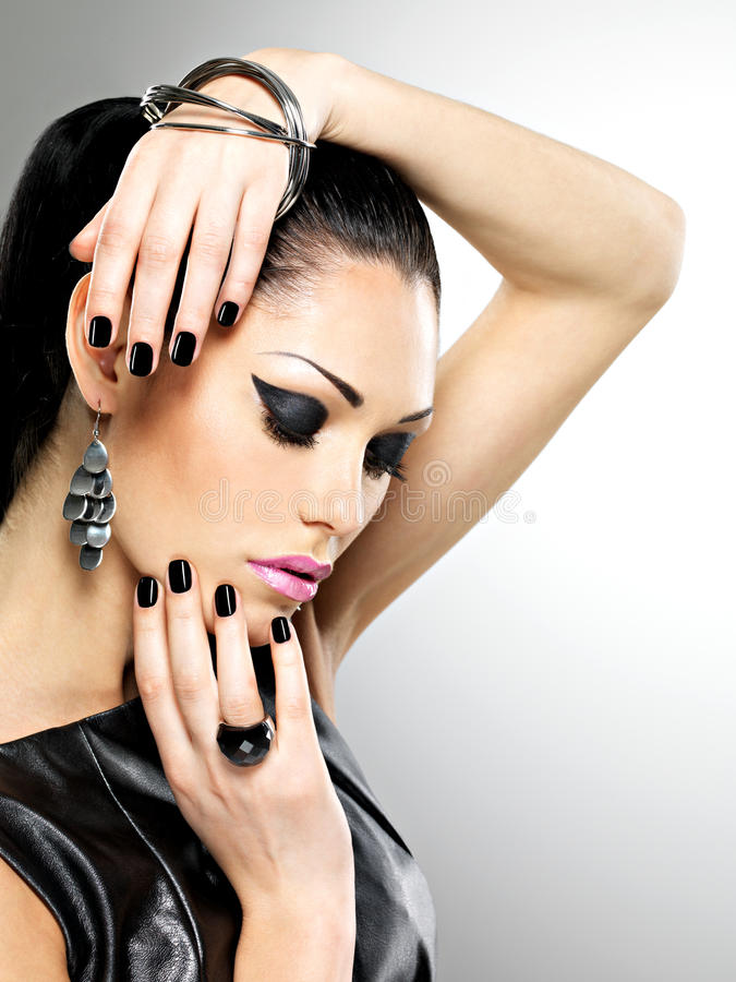 Beautiful fashion woman with black nails at pretty face stock photo