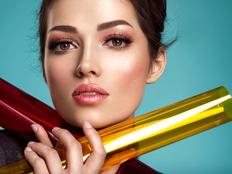 Beautiful fashion woman with  a colored  items.  Attractive white girl with living coral makeup royalty free stock image