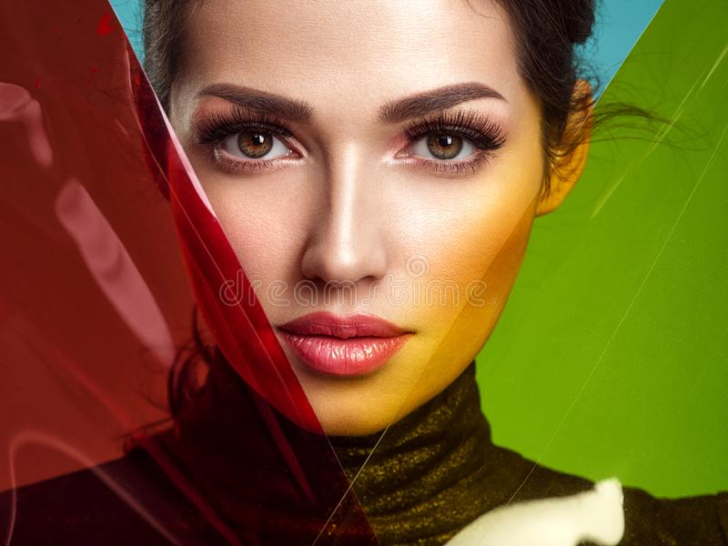 Beautiful fashion woman with  a colored  items.  Attractive white girl with living coral makeup stock photo