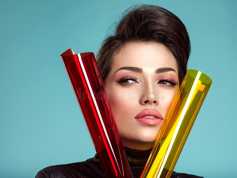 Beautiful fashion woman with  a colored  items.  Attractive white girl with living coral makeup royalty free stock photo