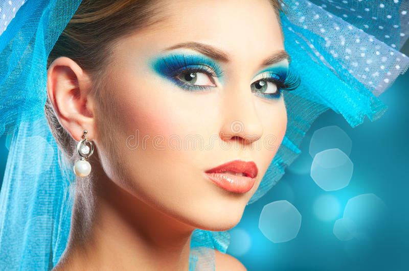 Beautiful Fashion Woman Face. Portrait of young woman with blue make-up stock images