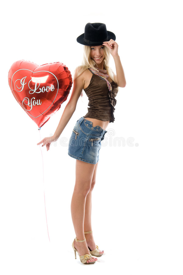 Beautiful fashion woman with a red party balloon. stock photo
