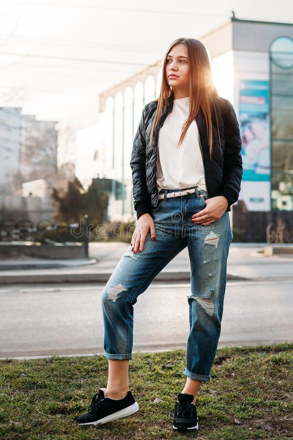 Beautiful fashion young woman at boulevard in urban scenery, downtown royalty free stock images