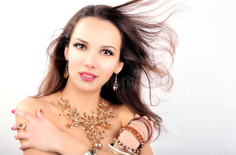 Beautiful fashion young woman with jewelry accessories royalty free stock images