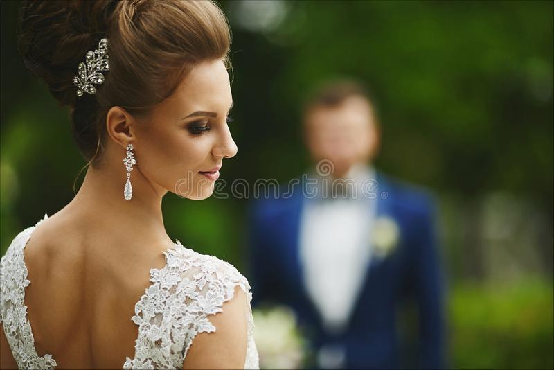 Beautiful and fashionable brunette model girl with bright make-up and with wedding hairstyle, young stylish bride in stock images