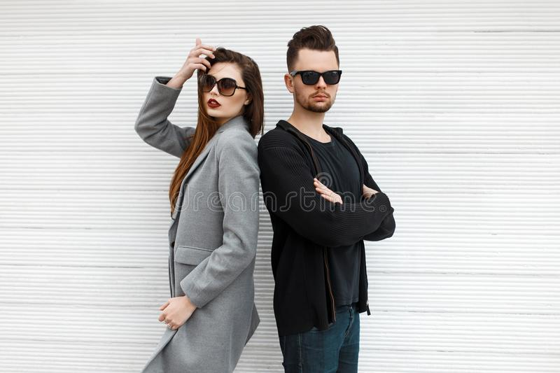 Beautiful fashionable couple with sunglasses in stylish modern stock photos