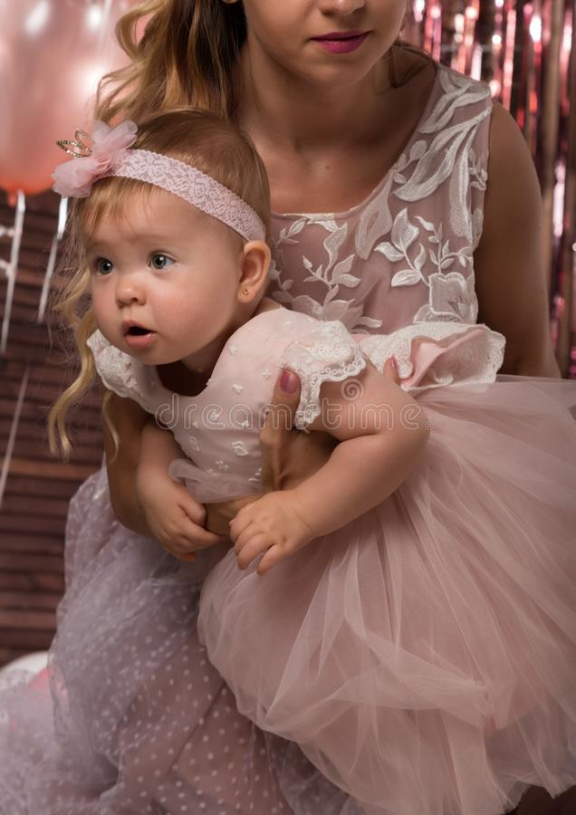 Beautiful fashionable little baby in pink dress. little princess poses like a doll stock photo