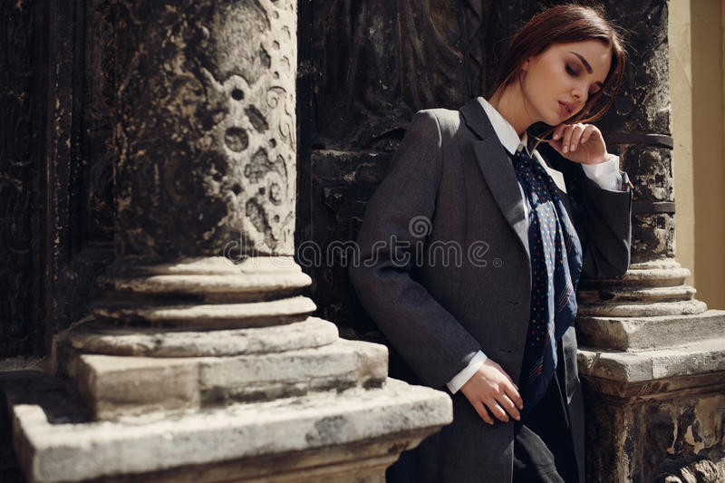 Beautiful Fashionable Woman In Fashion Clothes Posing In Street. Fashionable Woman In High Fashion Clothes Standing In Street. Beautiful Girl In Womanly Stylish royalty free stock photos