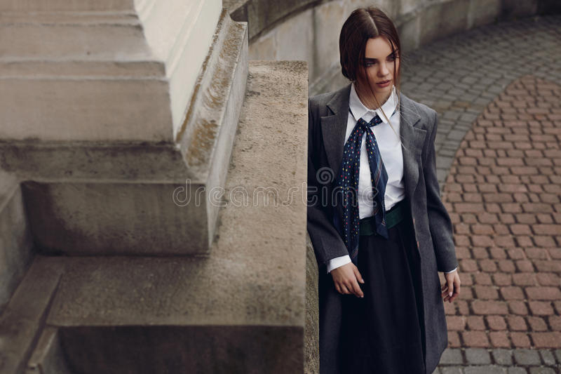 Beautiful Fashionable Woman In Fashion Clothes Posing In Street. Fashionable Woman In High Fashion Clothes Standing In Street. Beautiful Girl In Womanly Stylish royalty free stock images